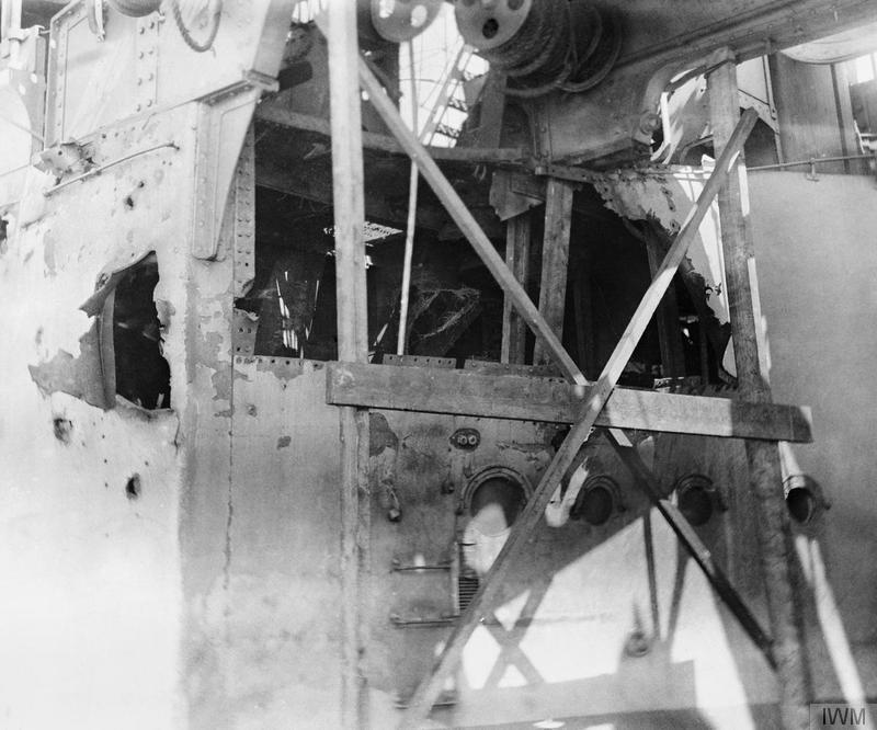 Damage to the superstructure of HMS COLOSSUS, the flagship of the 1st Battle Squadron. She was hit twice and suffered five casualties. © IWM (Q 55600)