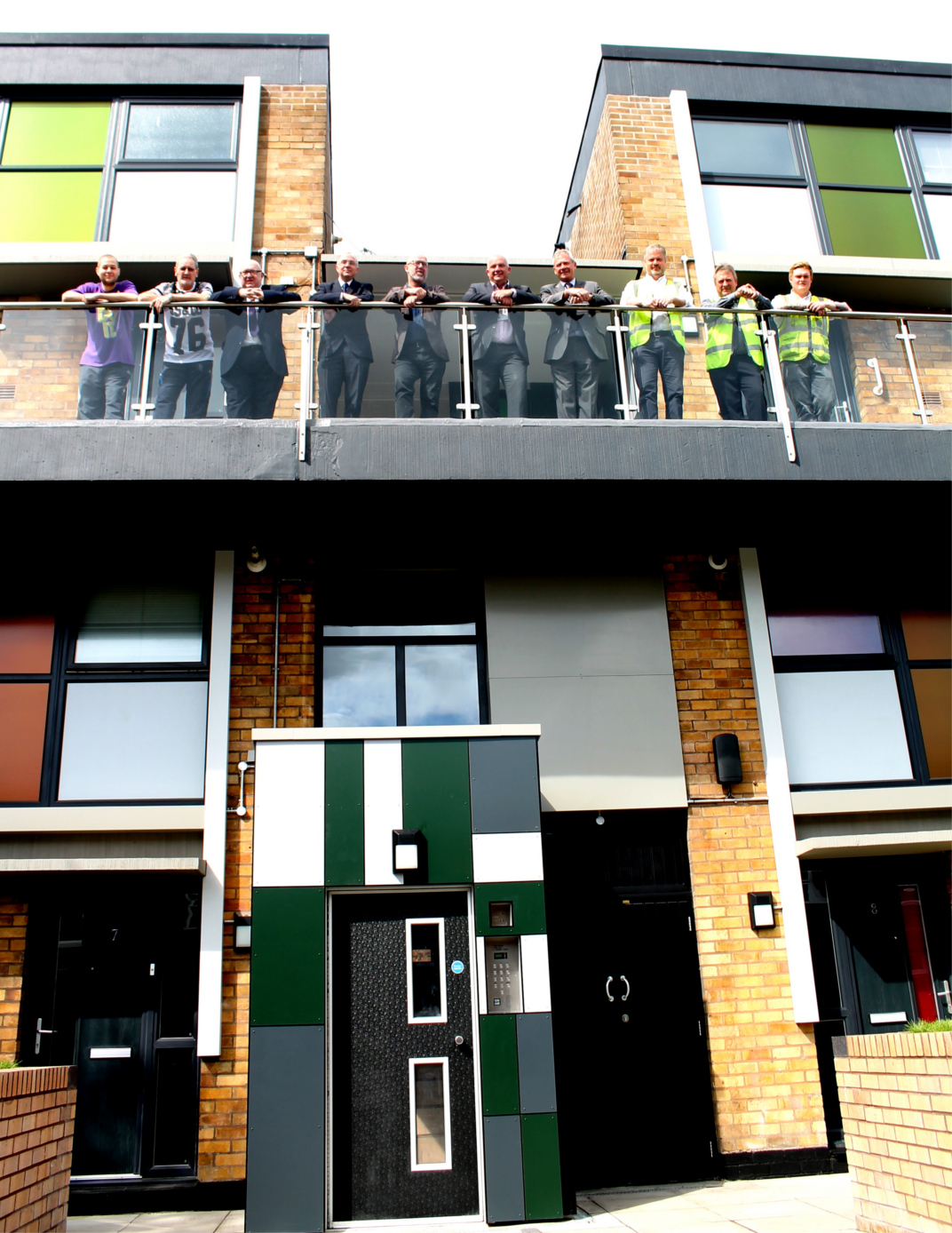 Workers celebrate with residents on the new entrances and upgrades