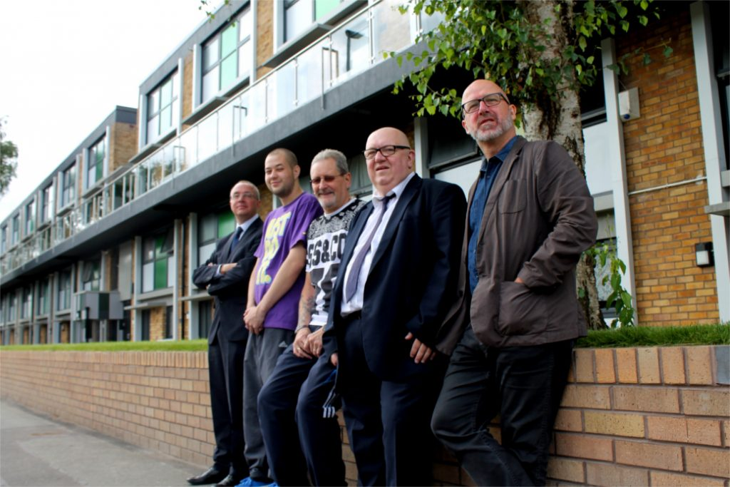 (R-L) Mark Foster (director for investment at Salix Homes), Cllr John Warmisham,  Langworthy ward, Cllr Paul Longshaw, lead member for housing, residents Francis Abella and Anthony Cadogan