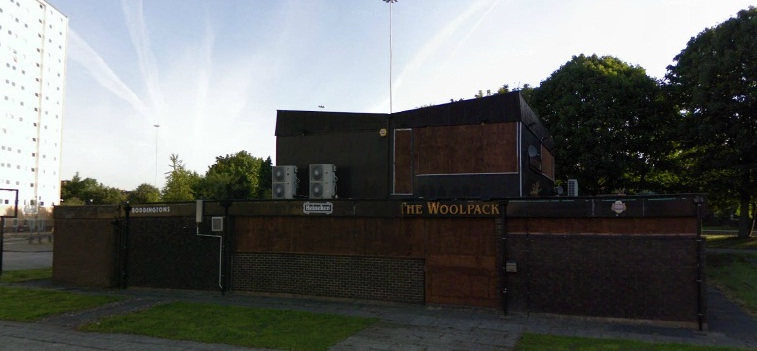 The Woolpack boarded up and derelict in 2012